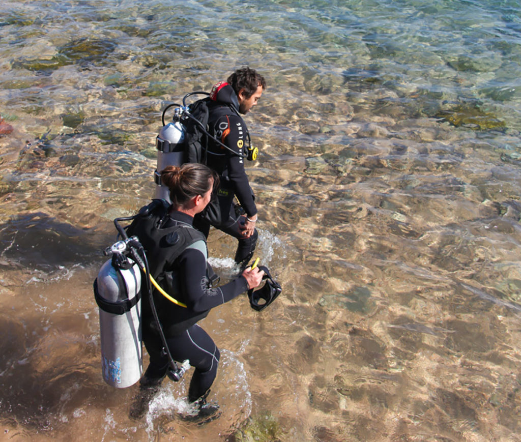Two Divers enter to sea in Dahab
