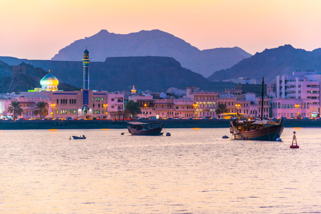 View of coastline of Muttrah district of Muscat during sunset, Oman