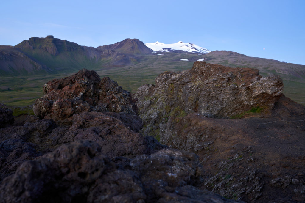 Beautiful view of the saxholl crater rock path in the foreground and with the Snæfellsjökull glacier in the distance