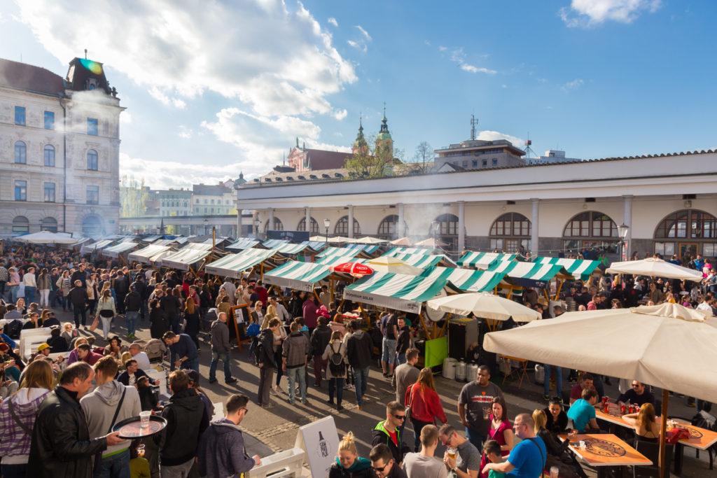 Enjoying outdoor street food festival in Ljubljana, Slovenia