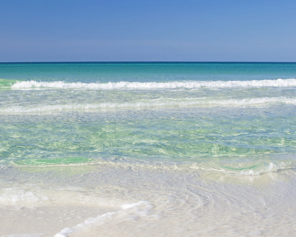 Green and turquoise waves on the Emerald Coast, Florida.