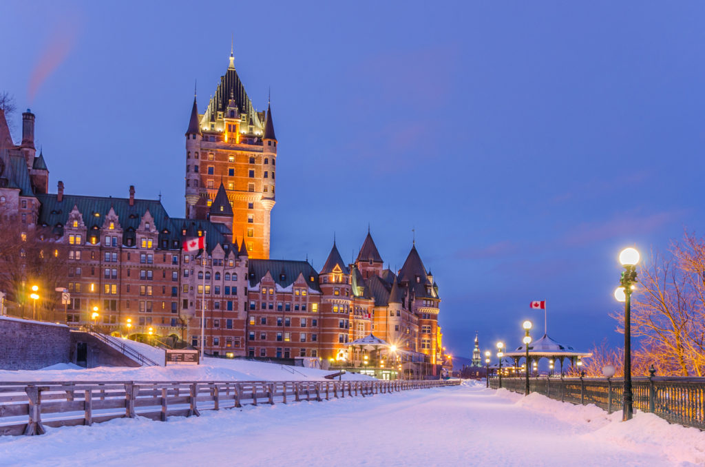 Night view of Chateau Frontenac in winter with Terrace Dufferin covered in snow, Quebec City, Canada.