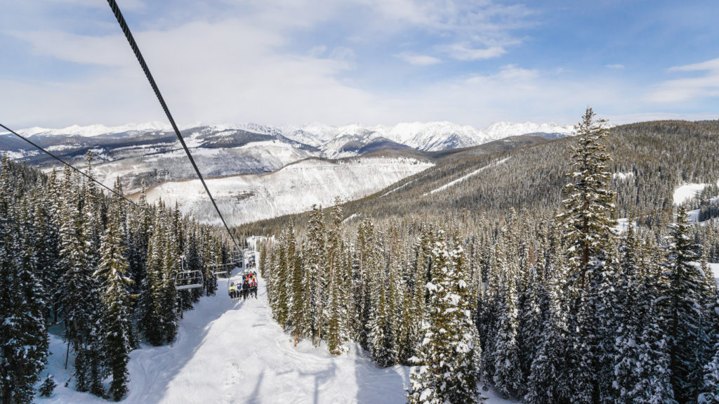 Ski Lift with Skiers in Vail, Colorado