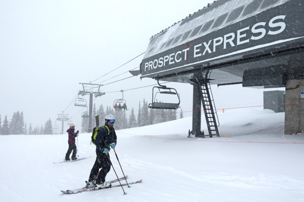 Skiers Waiting Under the Prospect Express Chair Lift at Telluride Ski Resort