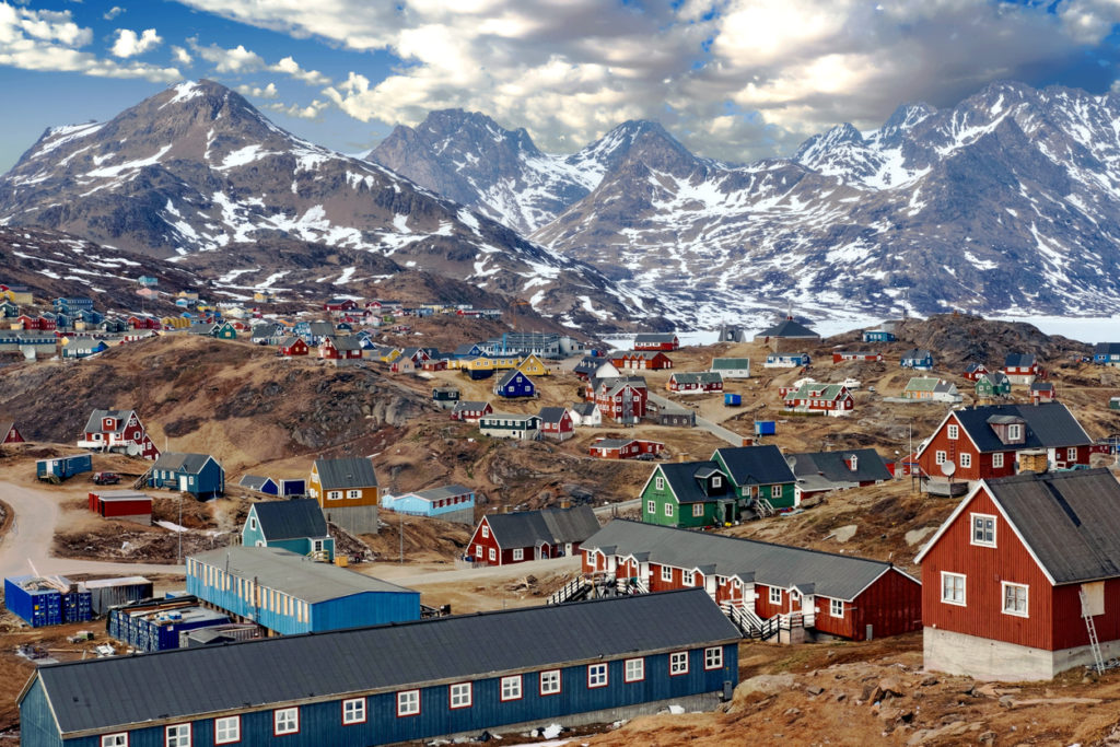Tasiilaq, a town surrounded by high mountains in Eastern Greenland