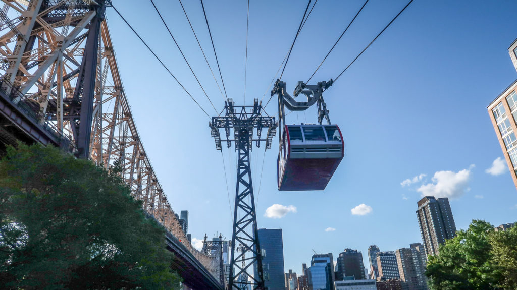 Roosevelt Island Tramway over city and East River at Manhattan