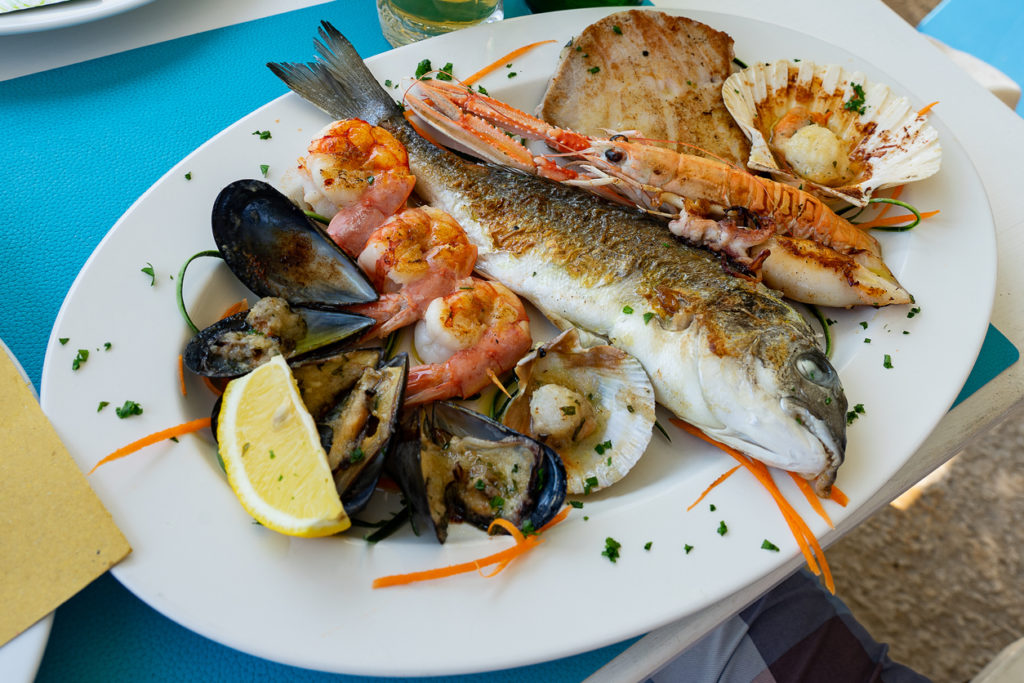 Seafood fish platter in Valun Cres island Croatia with tuna fish shrimps and mussels
