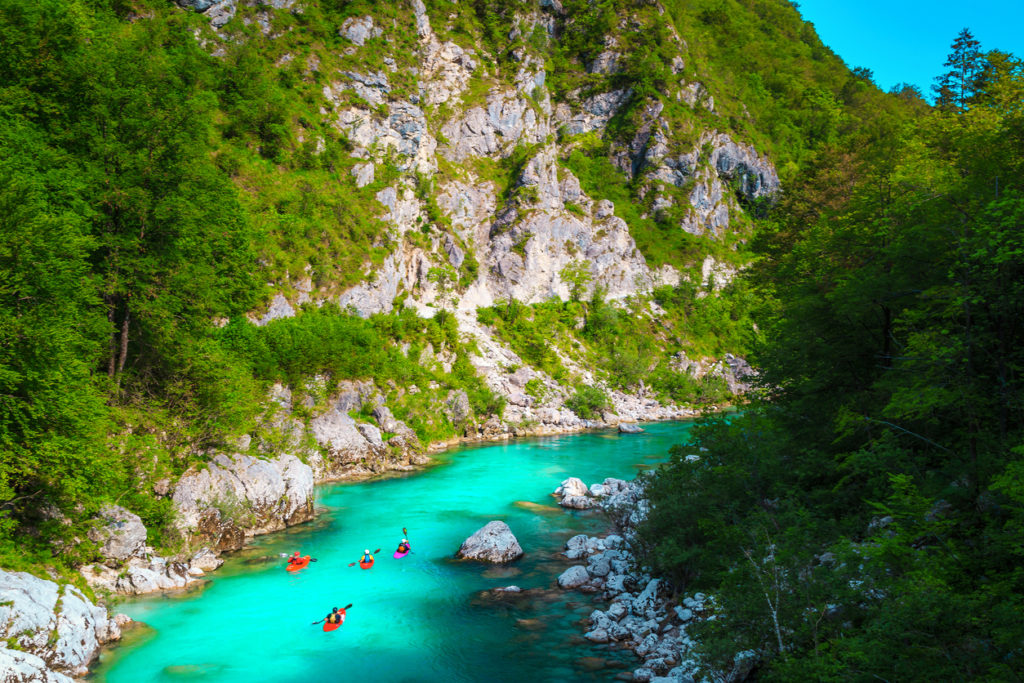 Kayakers on the spectacular turquoise Soca river