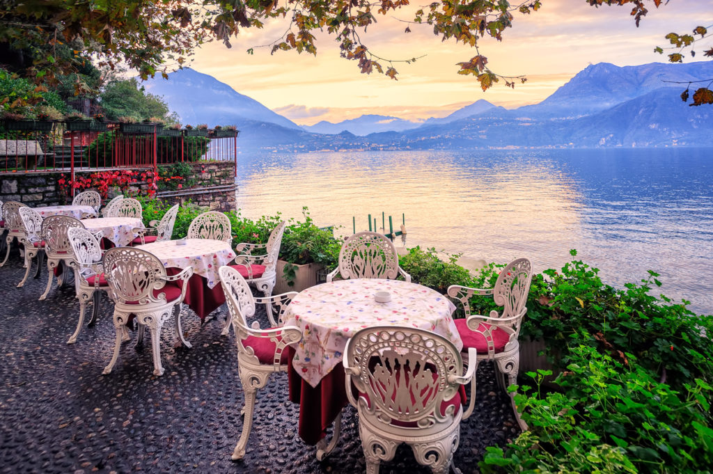 Tables in a small cafe at the waterfront of Lake Como, Italy