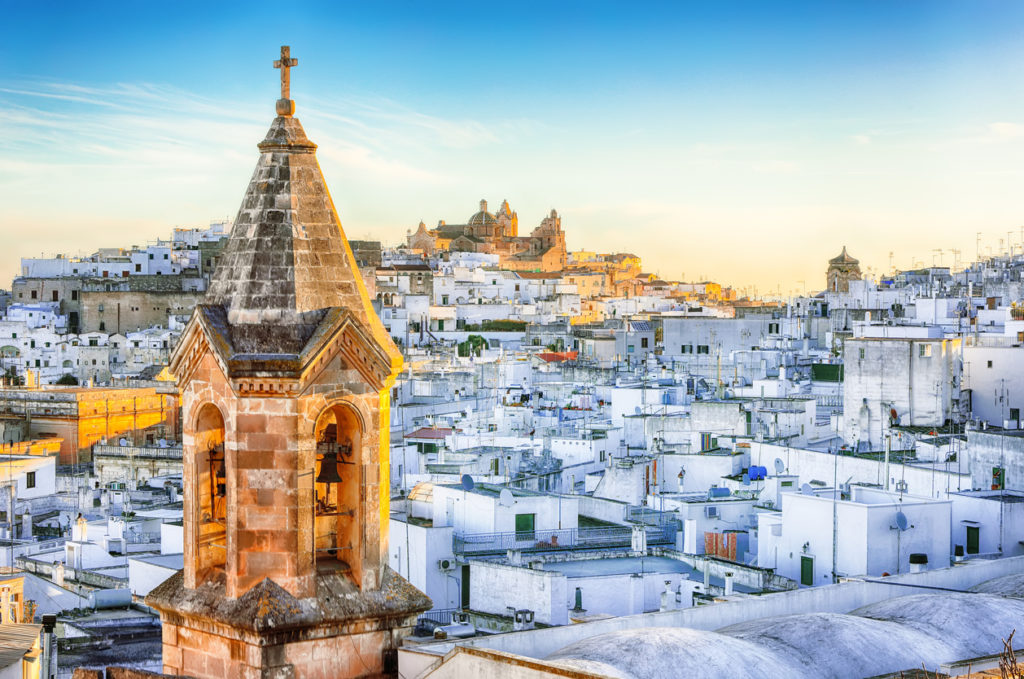 White town Ostuni and cathedral at sunrise