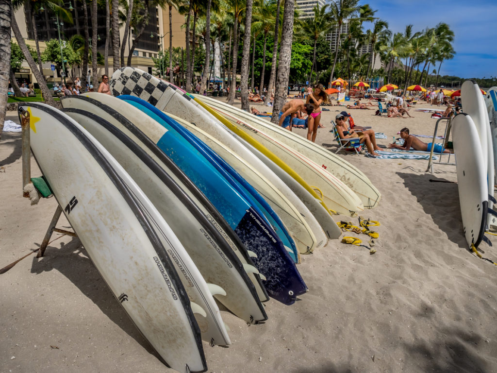 Surfboard rentals waiting for tourists on Waikiki beach