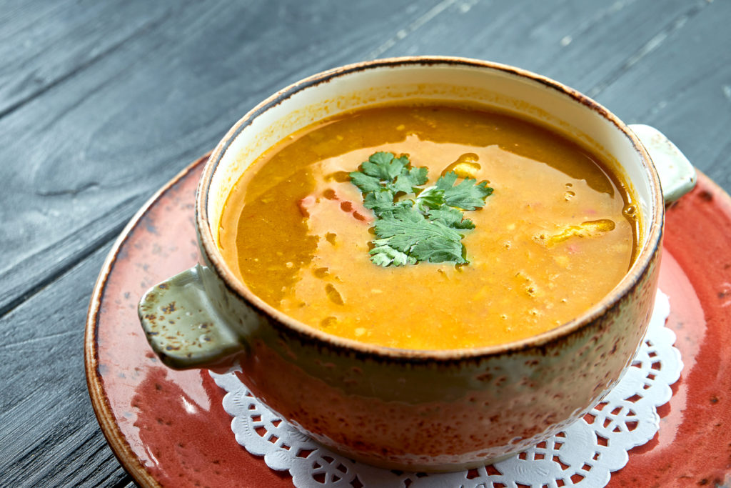 Traditional Moroccan soup - Harira, yellow lentil soup with cilantro