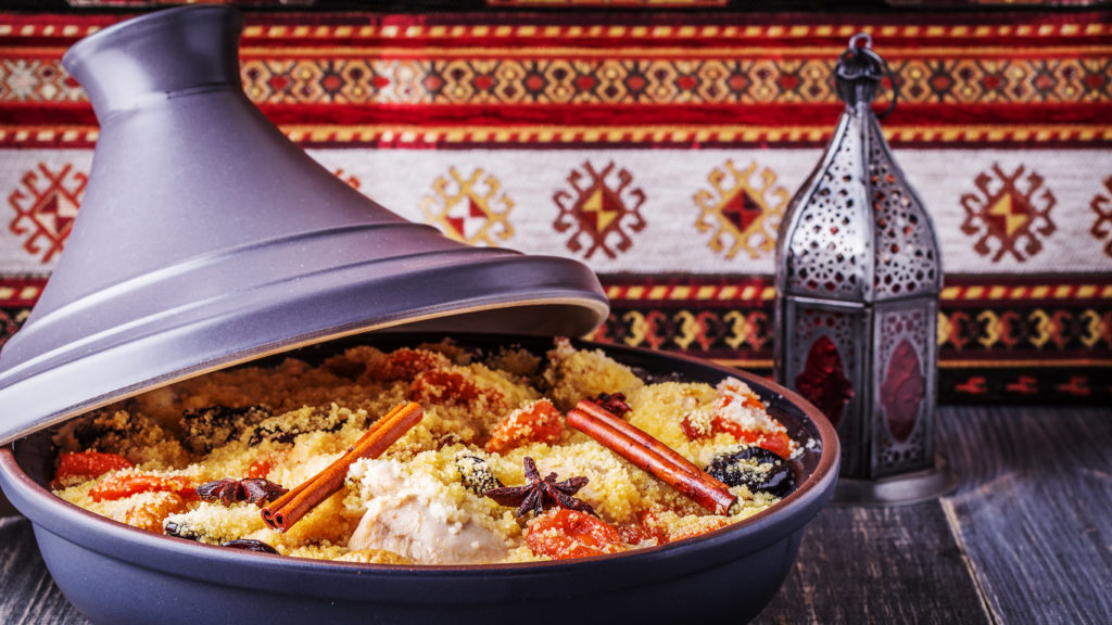 Traditional moroccan tajine of chicken with dried fruits
