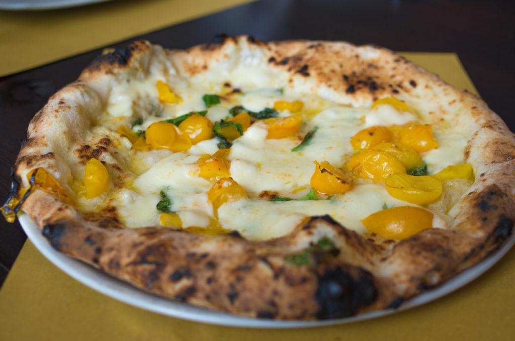 Neapolitan pizza with yellow tomato